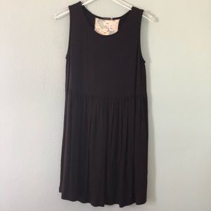 Boutique | Black sleeveless dress with lace panel